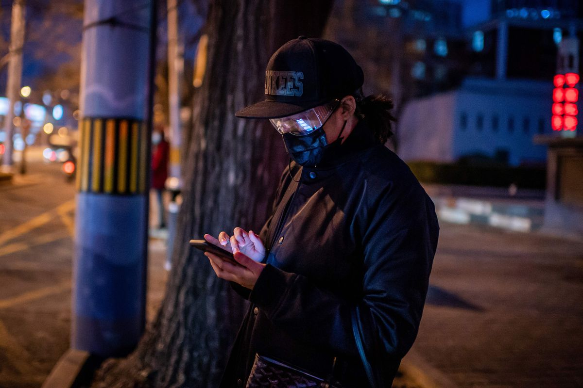 A person checking his phone