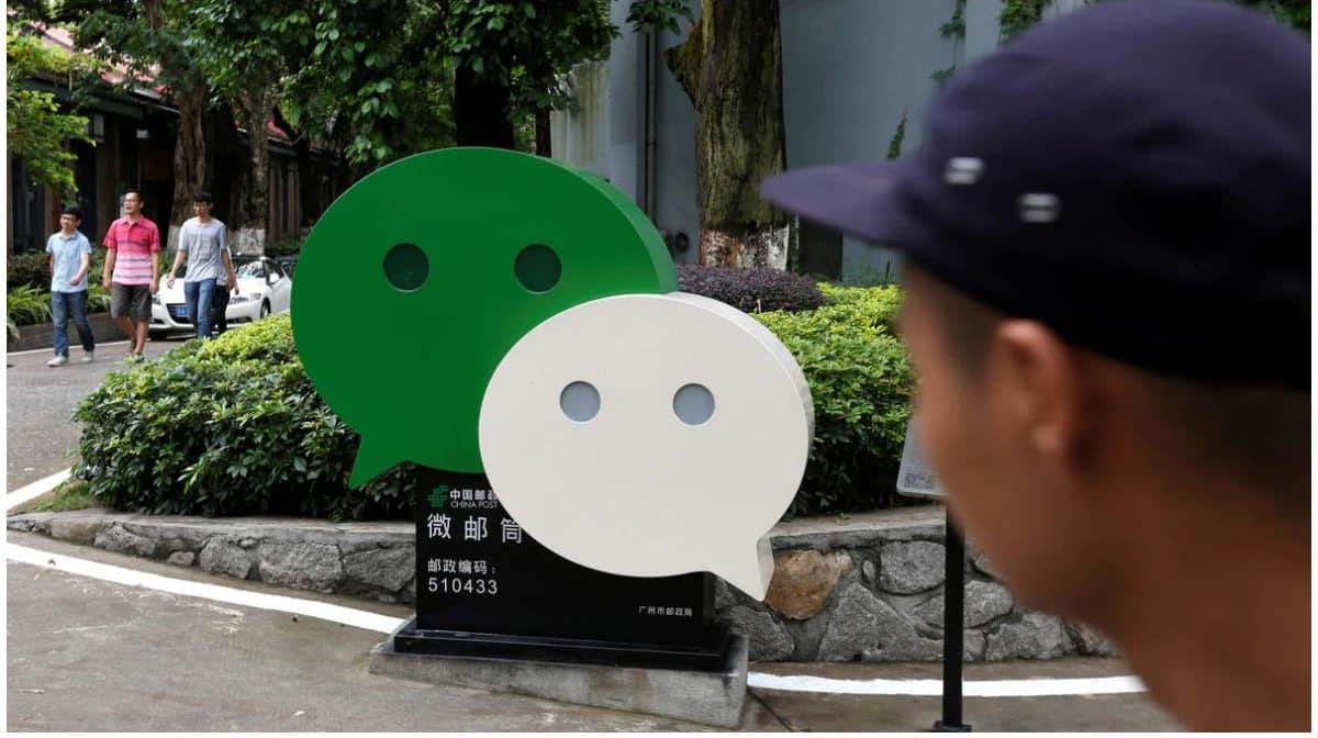 Boy staring at the WeChat logo