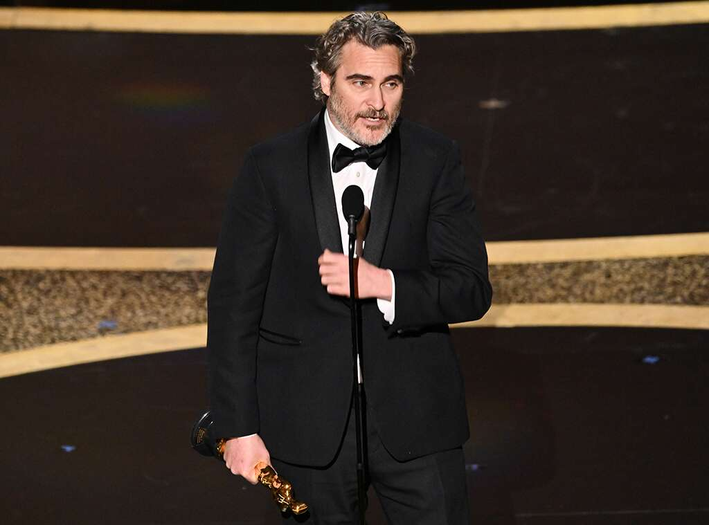 Joaquin Phoenic with the Best Actor award at Oscars